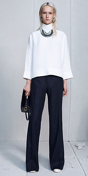 celine-black-hoop-earrings-black-pants-white-top